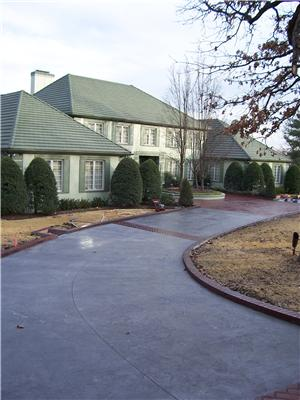 Concrete Driveway Design Ideas concrete parking pads with gravel in the middlemuch friendlier for auto Stamped And Colored Decorative Concrete Drivewaythrough Coloring And Stamp Patterns Concrete Driveways Can Enhance The Curb Appeal Of A Home
