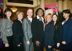 (S.USA Women's Financial Empowerment Roundtable Panelists, standing left to right) Deane Brown, Emilia DiMenco, Anne Ladky, Vikki Pryor, Cristina Benitez, Lindsay Tilchen Johnson, Marian Carrington