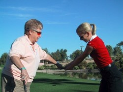 Sharon Miller teaches student how to correct her swing