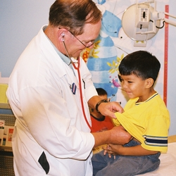 Dr. Frank Bowen examines a pediatric patient at The Volunteers in Medicine Clinic in Hilton Head, NC.