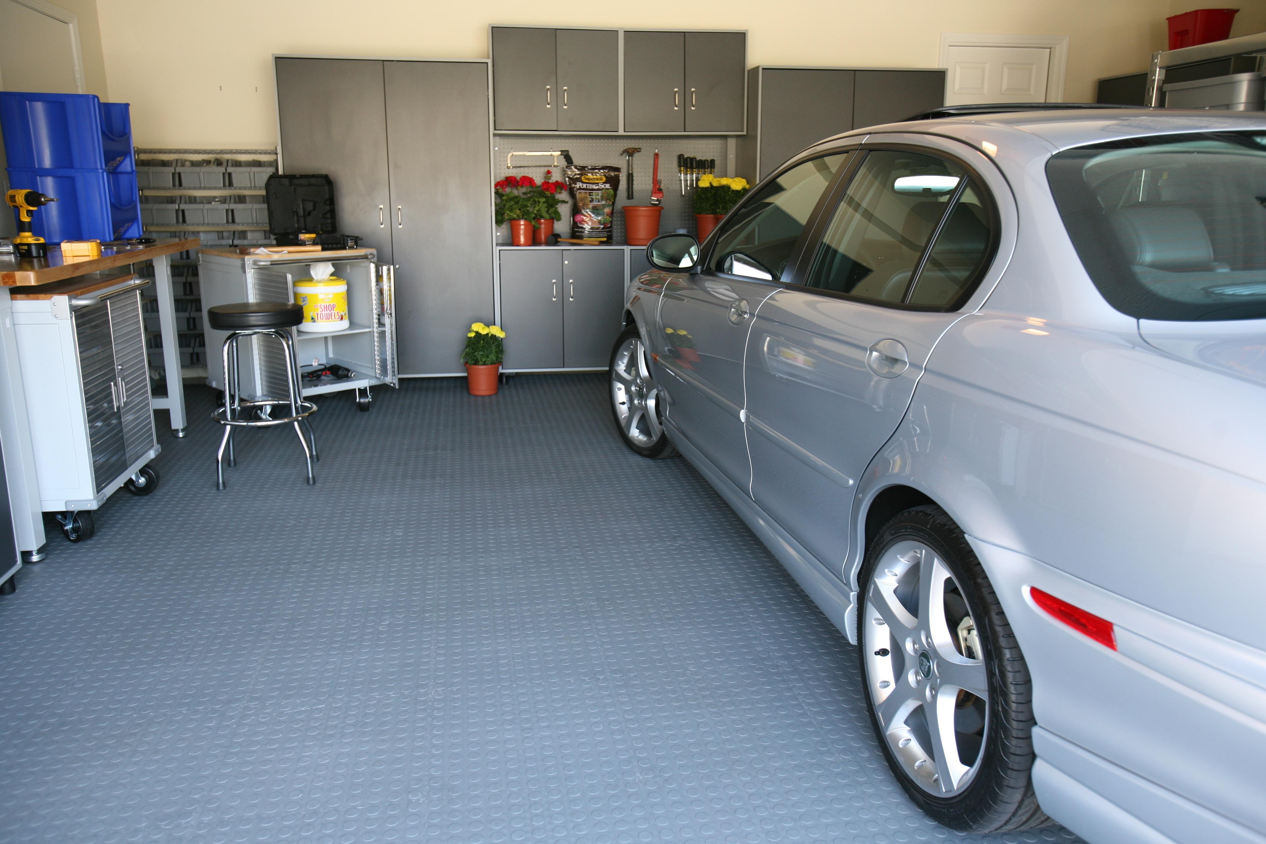 Garage Flooring In Action Garage Floor Tile Installed In A Garage