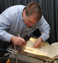 Conservator John Mumford doing conservation work on Codex Sinaiticus at The British Library