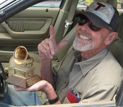 Tom Wilkes and his Grammy Award, taken a few weeks before his death in Pioneertown, CA. Photo by Fritz Drumm