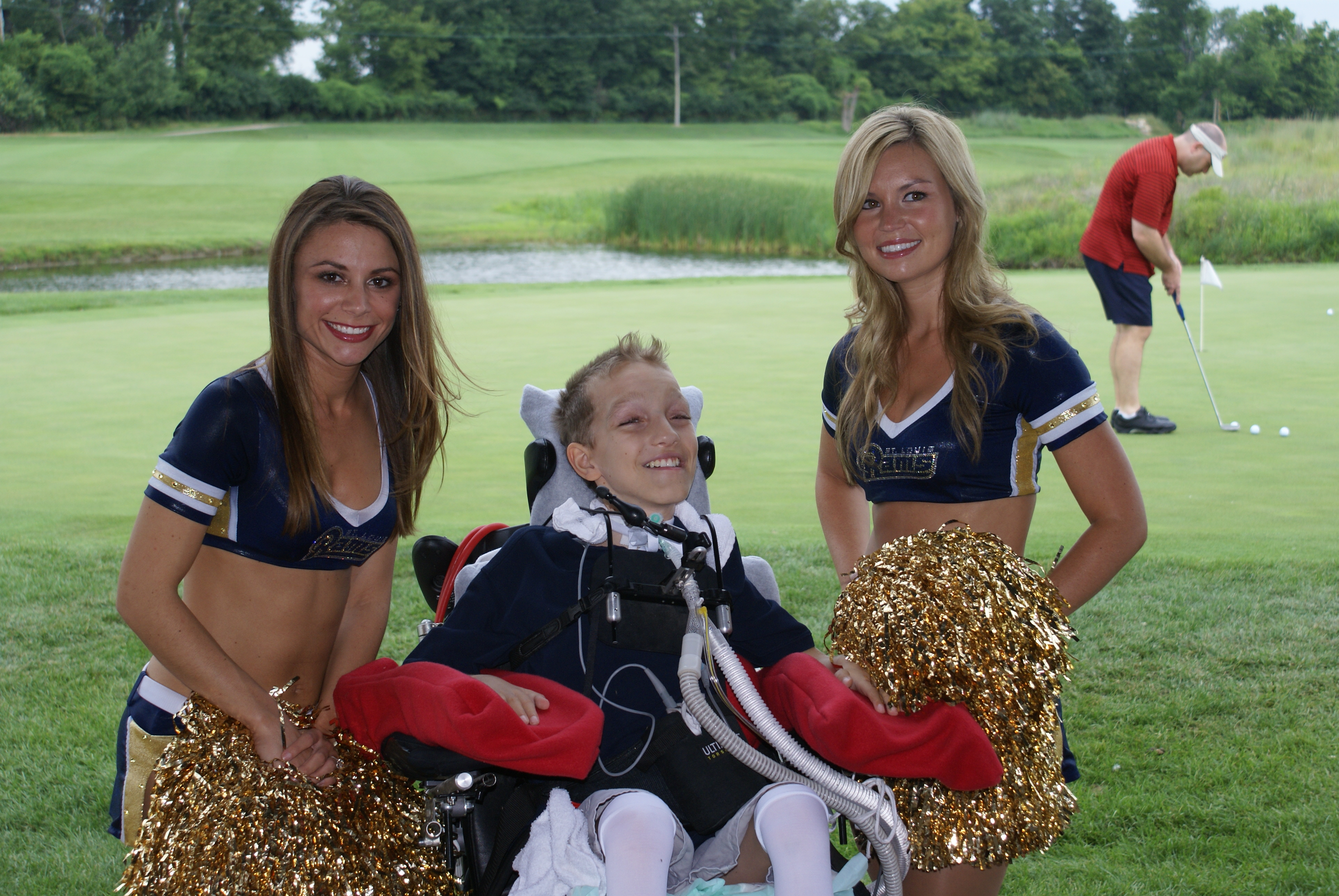 Alex Malarkey with two St. Louis Rams Cheerleaders