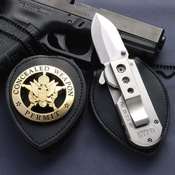 Badge with Hidden Knife