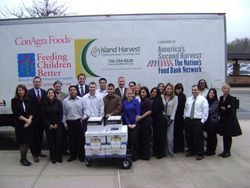 Lawyers and staff of Schwartzapfel Truhowsky Marcus P.C.  in front of Island Harvest food truck