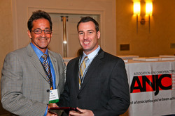 Chiropractic New Jersey - Billing Precision's Dr. Brian Capra (right) receives the award from Dr. Sig Miller at the ANJC Awards Ceremony