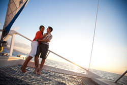 Couple on the Island Routes Caribbean Adventure Tours Lover's Rock Sunset Sail luxury catamaran tour, www.islandroutes.com.