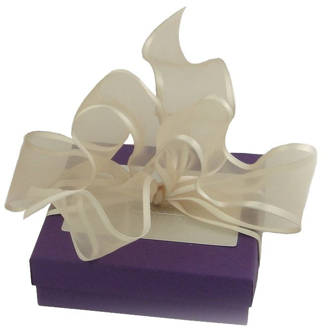 Loving heart gift is nestled in a purple gift box adorned with a hand