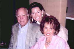 Mrs. Jean Schwarz (right) with her husband and daughter