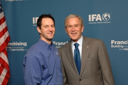Upside Group Franchise Consulting President Mario Altiery with President George W. Bush at the Private VIP FranPAC reception during the 2010 IFA Convention