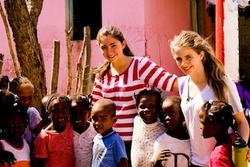 Kids to Kids Founder Julia Haney (far right) with children in the Dominican Republic