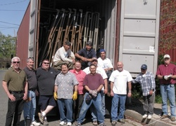 Volunteer crew loading hospital beds for Haiti relief. EHC Management and Rotary.