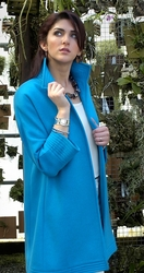This rich turquoise cashmere iPEARL topper length jacket features Trapunto stitching on the collar, cuffs and hemline.