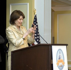 Congresswoman Cathy McMorris-Rodgers (R-5th WA) takes a picture of the audience with her Blackberry from the podium.