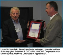 Three-time shuttle astronaut Loren Shriver (left) presents USA Space Shuttle Supplier Certificate of Appreciation to DUNMORE Corporation's President/CEO Matt Sullivan (right).