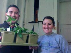 Young smiling couple with their first garden &quot;Lincoln Park Windowsill&quot;