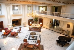 The elegant lobby of the Roberts Hotel includes nine skylights and ornate plasterwork.