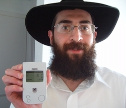 Danny Ace with Geiger Counter Reading 8 microRem/h (Normal Radiation)