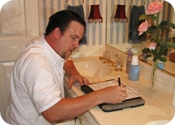 A licensed Berkey's plumber performs a preventive plumbing service home inspection.
