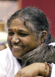 Amma 'The Hugging Saint' will visit Dallas, TX on June 27 and 28, 2010