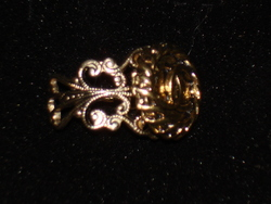 Vintage Chanel button re-purposed on a gold filigree ring band.  Find Chanel button rings, choker necklaces and cuff bracelets at http://etsy.com/shop/lynnjulian
