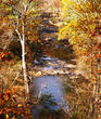 View of Snake Creek surrounded by the colors of fall