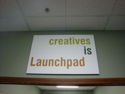 Launchpad Creatives signs hanging around the office