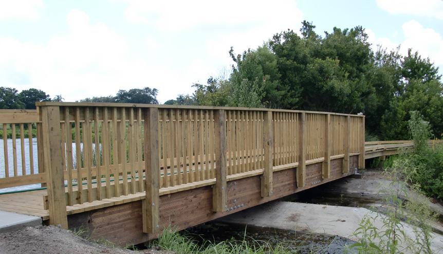 Timber free span bridge built by nature bridges at habitat park for st