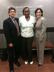 Attorneys and their client after civil rights jury verdict in their favor