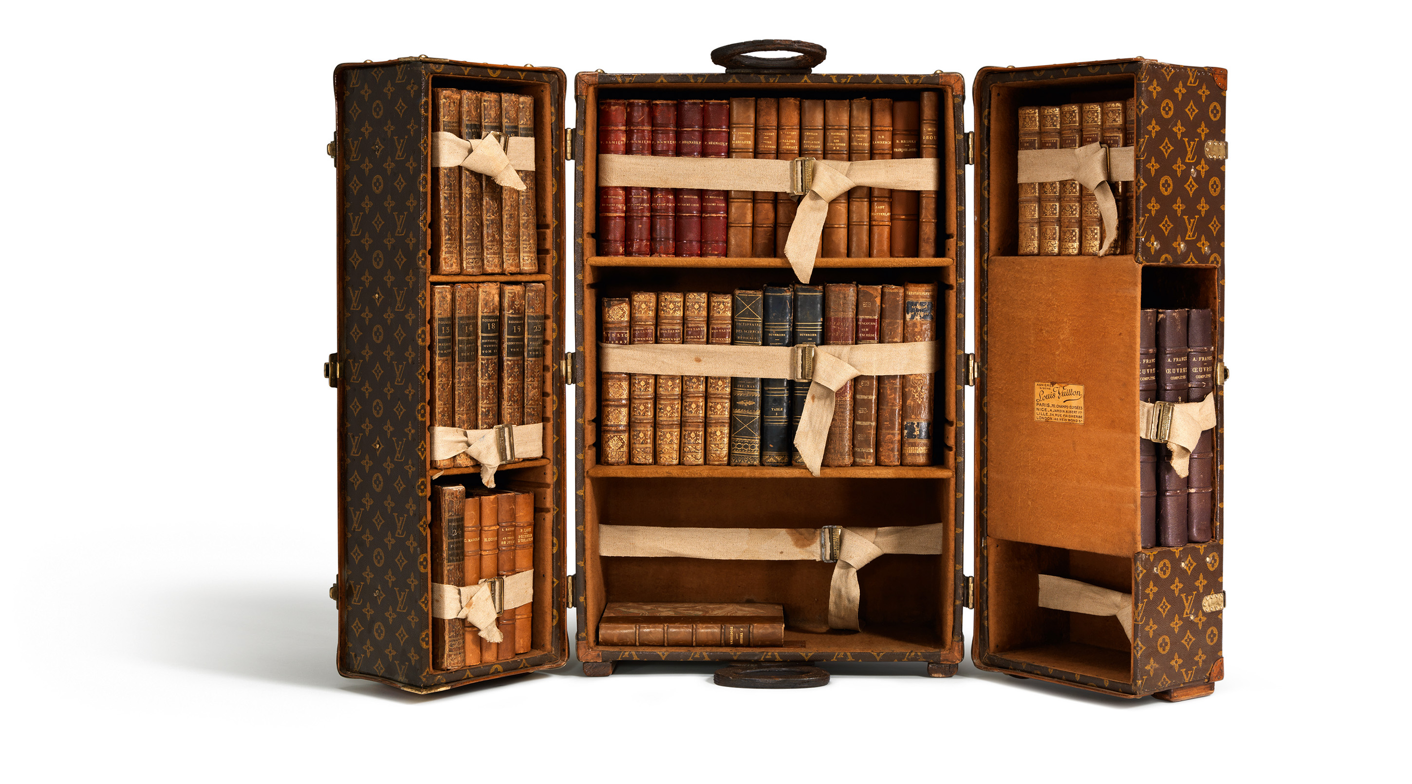 louis vuitton celebrates 100 legendary trunks. Black Bedroom Furniture Sets. Home Design Ideas