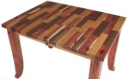 Custom furniture company Erik Organic introduces a spectacular new mixed wood  tabletop design that can be custom made into any table the company offers.