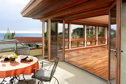 Lamboo laminated bamboo is available with NanaWall's WD65 wood-framed opening glass wall system.