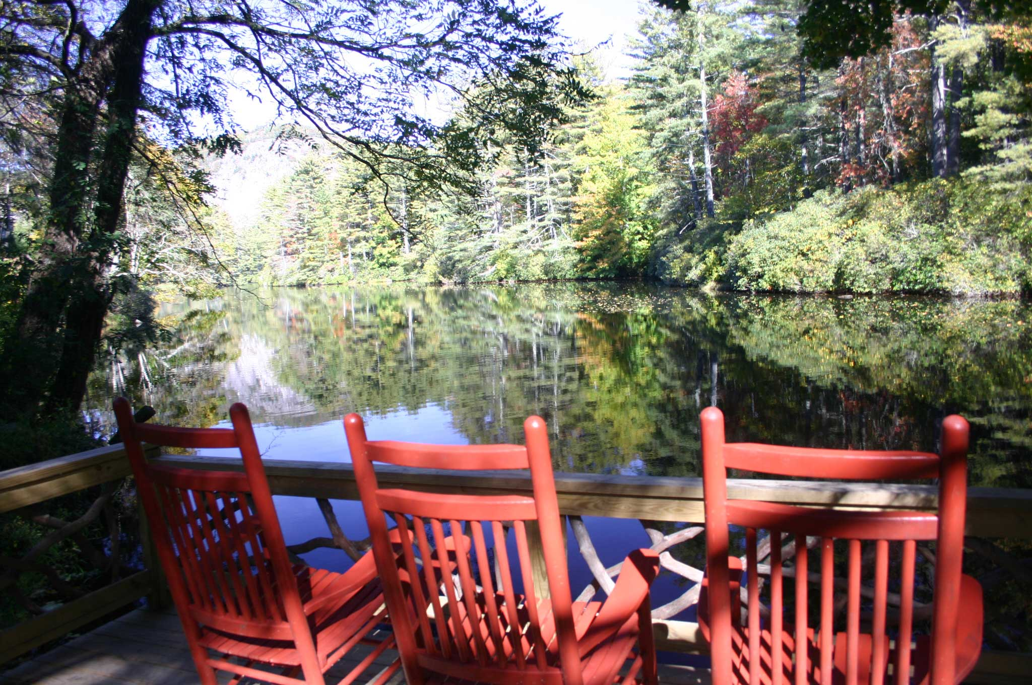 Colors Of Fall Foliage Are Reflected In Hampton Lake And Can Be Observed By Rocking  Chair Or Hiking Trails.