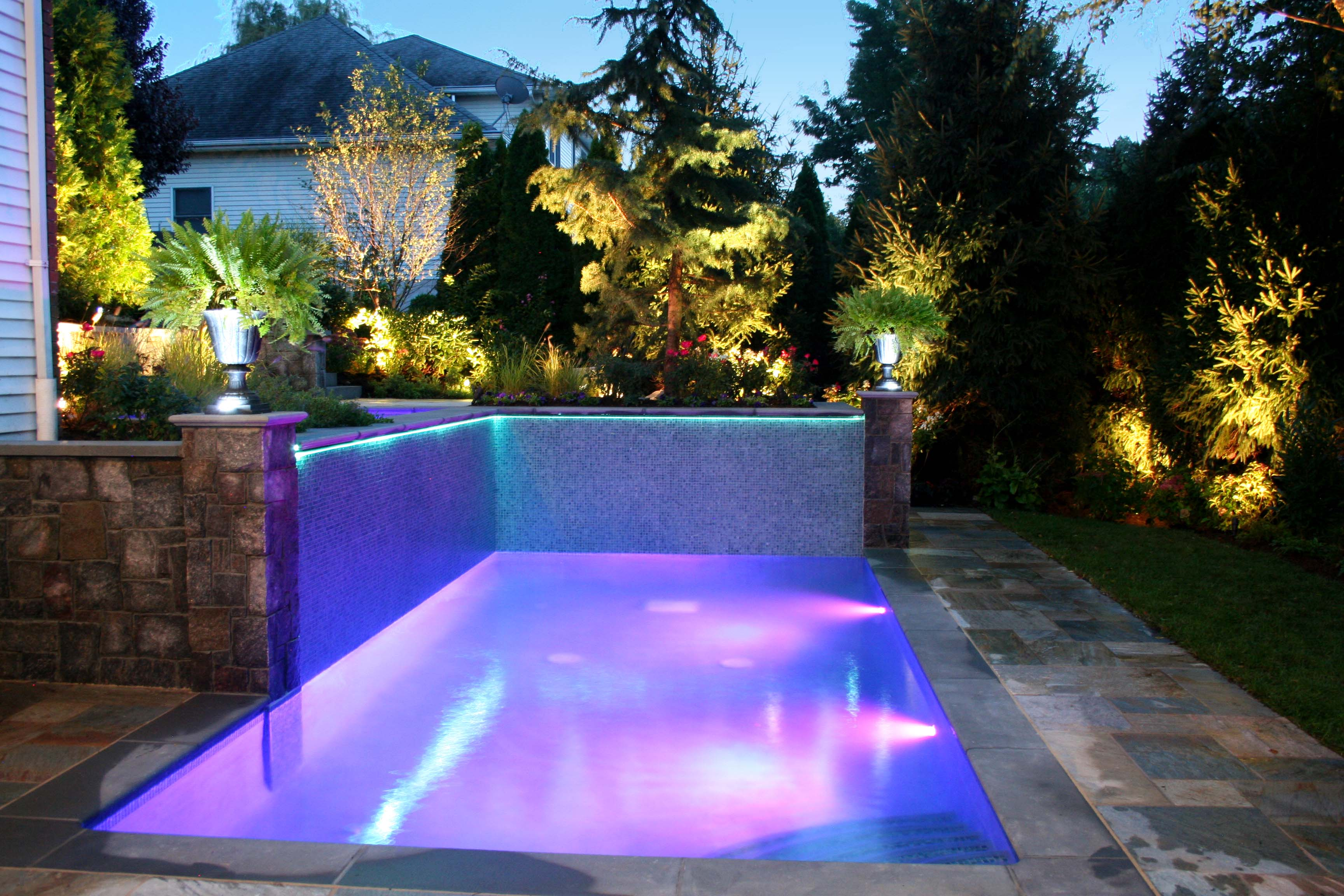 Glass tile swimming pool designs earn new jersey based for Garden pool designs ideas