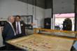 US Senator Ben Cardin watches robotic welding at Marlin Wire for custom wire baskets