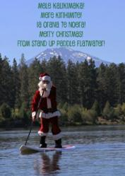 SUP Christmas Card Featuring Santa Claus Stand Up Paddling on the Deschutes River in Bend, Oregon.