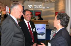 Thought Technology VP Lawrence Klein with Dr. Peter Boehm and Leslie Reissner