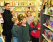Charlie and some of his classmates excitedly peruse the shelves of the new store shortly after the doors open.