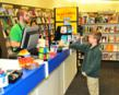 Charlie McClurg is honored as the first official customer of the Books-A-Million at Walnut Square Mall.