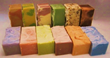 Sampling of all natural chemical-free creamy goat milk soaps from GoatMilkStuff.com, homemade by the Jonas family.