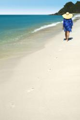Woman walking on the beach -  Caregiver Cruise sweepstakes