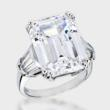 15.0 carat classic emerald cut cubic zirconia with three tapered baguettes on each side, set in 14K white gold