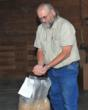 Stacy Boston checks quality at The Feed Mill. All-natural horse feed.