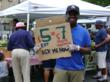 LGE teen promoting EBT use at their farm stand in the South Bronx. Photo courtesy of GrowNYC.