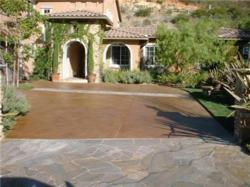 Concrete driveway stained in brown earth tones