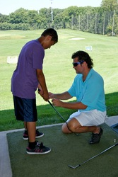 Hank Haney Pro Associate Golf Instructor Scott Cole giving a golf lesson to a junior golfer