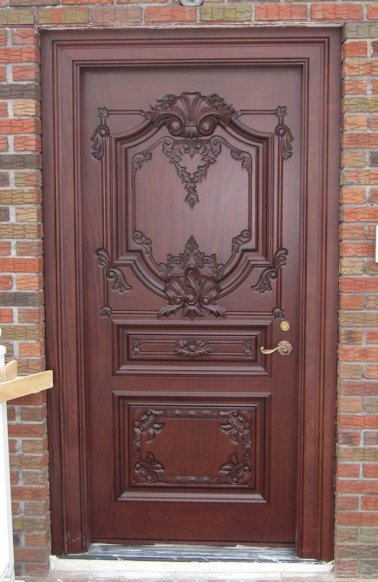 Wooden carving main doors native home garden design for Door design catalogue in india