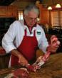 Cole Ward cutting meat off the bone