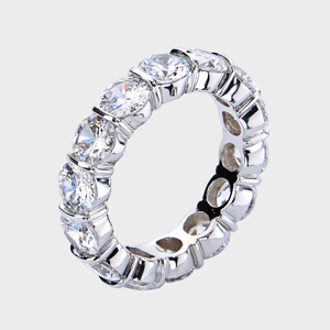 this high quality cubic zirconia ring features brilliant round stones channel set vertically in between gold bars - High Quality Cubic Zirconia Wedding Rings